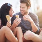 happy couple with ice cream near santa monica pier